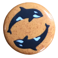 "1"" button of two orca whales against a mottled orange background"